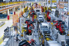 Automotive production line. Welding car body. Modern car Assembly plant royalty free stock photo