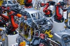 Automotive production line. Welding car body. Modern car Assembly plant. Assembly line production of new car. Automated welding of car body on production line royalty free stock image