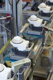 Assembly line for the production of plastic components Stock Image