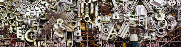 Assembly of machine parts. Abstract background of differently assembled metal machine parts stock photography