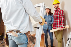 Assembly of new window. By workers at construction site stock image