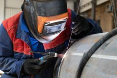 Welder, arc welding and weld seam close-up royalty free stock image