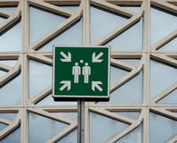 Assembly point sign. In front of a modern building royalty free stock photo