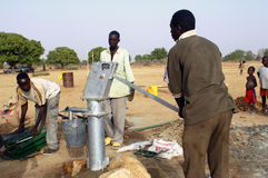Assembly of a pump in Burkina Faso Stock Images