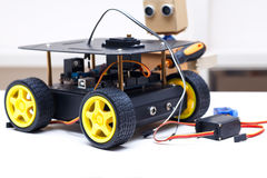 Assembly robot on wheels and robot with arms. Assembly robot on wheels on the table royalty free stock photo