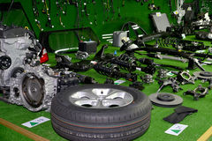 Assembly set of details of the car are spread out on a green sur Stock Photography