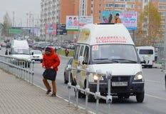 Assenger exiting the taxi on Sverdlov Street in Balashikha. Russia. Stock Photo