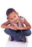 Assento adorável da criança Imagem de Stock Royalty Free
