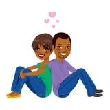 Assento afro-americano dos pares Foto de Stock