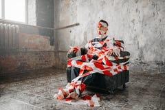 Assento autístico em uma cadeira no meio da sala Fotografia de Stock Royalty Free