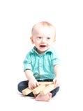 Assento de sorriso do bebê guardando a letra E Imagem de Stock Royalty Free