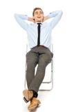 Assento despreocupado do homem de negócios Imagens de Stock Royalty Free