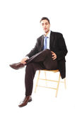 Assento do homem de negócios fotografia de stock royalty free
