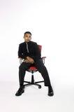 Assento do homem novo Imagens de Stock Royalty Free