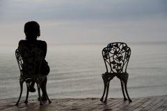 Assento e pensamento Fotografia de Stock