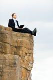 Assento nas rochas Imagem de Stock Royalty Free