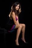 Assento no preto Imagem de Stock Royalty Free