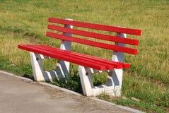 Assento/parque vermelhos fotografia de stock