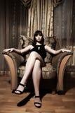 Assento 'sexy' da mulher Imagens de Stock
