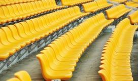 Assentos amarelos do futebol Imagens de Stock Royalty Free