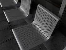 Assentos cinzentos do metal Fotos de Stock Royalty Free
