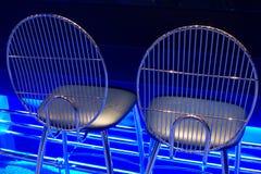 Assentos com fulgor de néon azul Foto de Stock Royalty Free