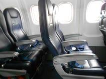 Assentos da economia do avião imagens de stock royalty free