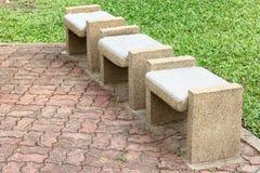 Assentos de bancos de pedra foto de stock