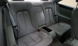 Assentos de couro cinzentos traseiros do veículo Imagem de Stock Royalty Free