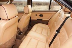 Assentos de creme traseiros do veículo do couro da cor Foto de Stock