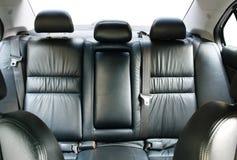 Assentos de passageiro traseiros em um carro Fotos de Stock Royalty Free