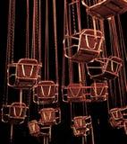 Assentos de um carrossel na noite foto de stock