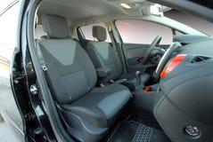 Assentos dianteiros de um carro moderno Imagem de Stock Royalty Free