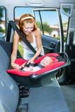 Assentos do bebê no banco de carro Fotografia de Stock Royalty Free