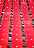 Assentos vermelhos do estádio Fotografia de Stock Royalty Free