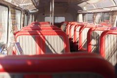 Assentos vermelhos do ônibus Imagem de Stock Royalty Free