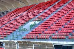 Assentos vermelhos no nacional Statium de Supachalasai Fotografia de Stock