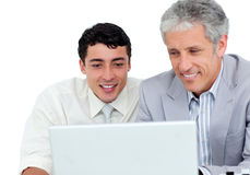 Assertive business co-workers using a laptop Royalty Free Stock Photo