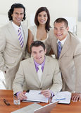 Assertive business people studying a document Stock Photos