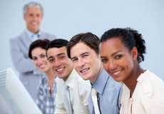 Assertive business team with their senior manager stock photography