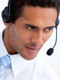 Assertive businessman with earpiece on Stock Photo