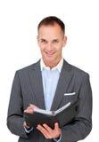 Assertive businessman holding an agenda Royalty Free Stock Photography