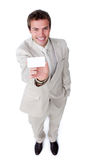 Assertive businessman holding a white card Stock Photos