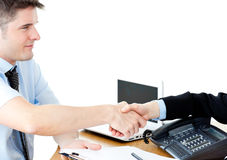 Assertive businessman shaking hands with customer Stock Images