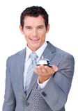 Assertive businessman showing a service bell. Against a white background Royalty Free Stock Images