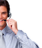 Assertive Businessman talking on headset. Against a white background Stock Photos