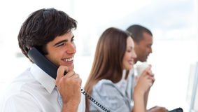 Assertive businessman talking on phone Stock Photo