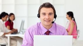 Assertive businessman using headset. In the office Stock Images
