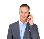 Assertive businessman using a mobile phone Royalty Free Stock Photos