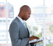 Assertive businessman working at a laptop Stock Photos